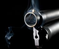 Hot Shotgun. Smoke around and in the muzzle of a shotgun Royalty Free Stock Images