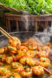 Hot shrimp fried in a pan with butter Royalty Free Stock Photography
