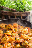 Hot shrimp fried in a pan with fresh herbs Royalty Free Stock Photography