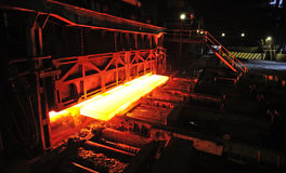 Hot slab in steel plant. Hot slab on conveyor in steel plant Stock Images