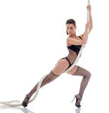 Hot slender model posing hanging on rope Stock Photos