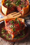 Hot sliced Chicago deep dish pizza closeup on a plate. vertical Royalty Free Stock Photo