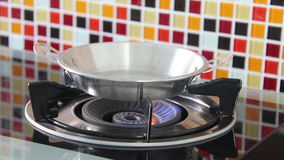 Hot Small Frying Pan On Opening Natural Blue Gas Stove. Hot Small Frying Pan On Opening Natural Blue Gas Stove In Kitchen Room stock footage
