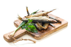 Hot smoked fish on a white background. Stock Image