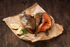 Hot smoked salmon`s heads on crumpled paper Stock Photography