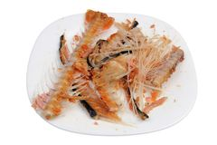 Hot smoked   salmon waste  trims  -  bones and fins  as low cost delicacy on plate isolated macro. Hot smoked   salmon waste  trims  -  bones and fins  as low royalty free stock images