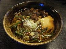 Hot soba. Kinoko soba japanese hot noodles Royalty Free Stock Photos