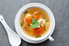 Hot soup chicken healthy at morning on concrete table.  royalty free stock photography