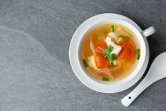 Hot soup chicken healthy at morning on concrete table.  stock images