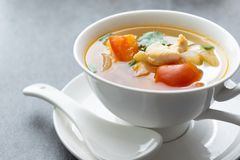 Hot soup chicken healthy at morning on concrete table.  stock photos