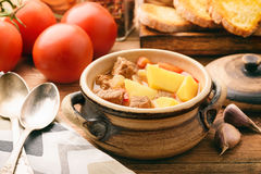 Hot soup goulash on brown wooden table. Stock Image