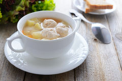 Hot soup with meatballs in white bowl Royalty Free Stock Photo