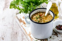 Hot soup with noodles in a mug stock photo