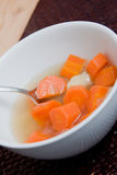 Hot soup in white bowl. Carrot potato soup served in a white bowl grandmas recipe Stock Images