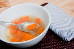 Hot soup in white bowl. Carrot potato soup served in a white bowl grandmas recipe Royalty Free Stock Photos