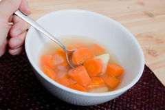 Hot soup in white bowl. Carrot potato soup served in a white bowl grandmas recipe Royalty Free Stock Image