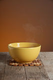 Hot soup in yellow bowl Stock Photo