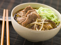Hot and Sour Beef Broth With Spinach Ramen Noodles Royalty Free Stock Image