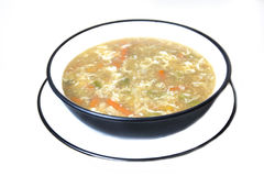 Chicken and vegetables soup in a bowl and a plate Stock Photography