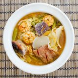Hot and sour curry with tamarind sauce, shrimp and snakehead and Stock Image