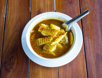 Hot and sour, fish with coconut, thai food in plate on the wood Stock Images