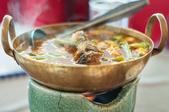 Hot and sour, fish and vegetable ragout. In hot cooking pot, Gaeng-som food in thailand Royalty Free Stock Photos