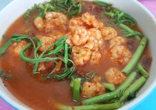 Hot and sour soup in a bowl ,, Thai hot spicy. Sour soup with shrimp and water mimosa in a bowl Stock Photos