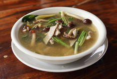 Hot and sour soup with pork and mushroom Stock Images