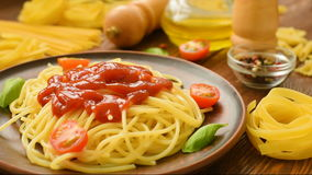 Hot spaghetti with ketchup and fresh tomatoes stock video