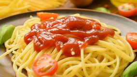 Hot spaghetti with ketchup and fresh tomatoes stock footage