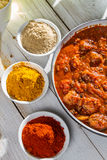 Hot spaghetti in a pan and spices royalty free stock image
