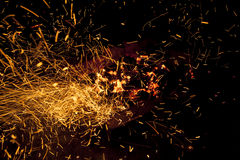 Hot sparking live-coals burning in a barbecue Royalty Free Stock Photography