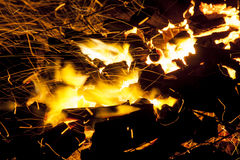 Hot sparking live-coals burning in a barbecue Stock Image