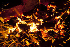 Hot sparking live-coals burning in a barbecue Royalty Free Stock Image