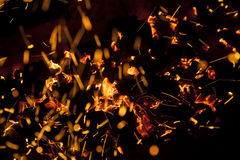 Hot sparking live-coals burning in a barbecue Stock Photos