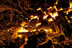 Hot sparking live-coals burning in a barbecue Royalty Free Stock Photo