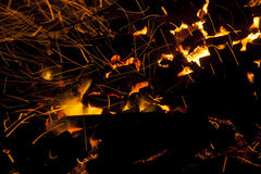 Hot sparking live-coals burning in a barbecue Stock Photography