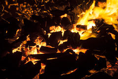 Hot sparking live-coals burning in a barbecue Stock Images