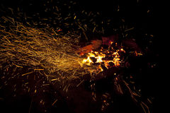 Hot sparking live-coals burning in a barbecue Royalty Free Stock Images
