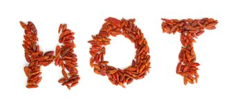 Hot spelled with peppers. The word hot spelled out with red peppers Stock Image