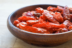 Hot spice, dried red chili in a wodden bowl Stock Image