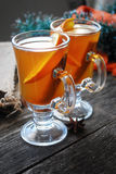 Hot spiced apple cider with orange and cinnamon Royalty Free Stock Photo
