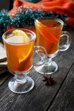 Hot spiced apple cider with orange and cinnamon Stock Photo
