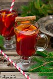 Hot spiced drink from infused tea with rum and mandarin. Hot spiced drink from infused tea with rum, cherries and mandarin Stock Images