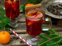 Hot spiced drink from infused tea with rum and mandarin. Hot spiced drink from infused tea with rum, cherries and mandarin Stock Photos