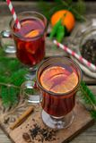 Hot spiced drink from infused tea with rum and mandarin. Hot spiced drink from infused tea with rum, cherries and mandarin Royalty Free Stock Photos