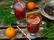 Hot spiced drink from infused tea with rum and mandarin. Hot spiced drink from infused tea with rum, cherries and mandarin Stock Photo