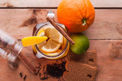 Hot spiced tea in jar on wooden table Stock Photography