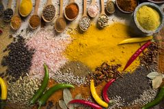 Hot spices in wooden bowls royalty free stock photo