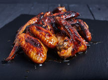 Hot spicy bbq honey chicken wings Royalty Free Stock Photos